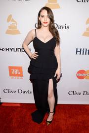 Kat Dennings flaunted both cleavage and legs and this tiered black gown during the Pre-Grammy Gala.