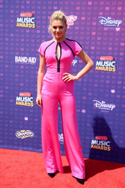 Kelsea Ballerini went for some '70s groove in a pink keyhole-detail jumpsuit by Thai Nguyen for her Radio Disney Music Awards look.