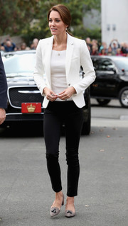 A crisp white blazer by Zara provided a smart finish.