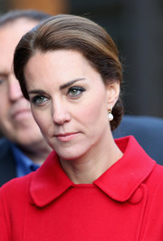 Kate Middleton looked appropriately regal wearing this classic chignon while touring McBride Museum in Canada.