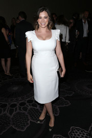 Rachel Bloom polished off her look with black and silver cap-top pumps.