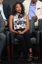 Kylie Bunbury completed her attire with edgy black strappy sandals.