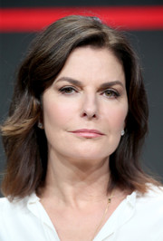 Sela Ward styled her hair with flippy waves for day 4 of the 2016 Summer TCA Tour.