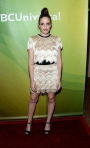 Carly Chaikin opted for a matchy-matchy look, pairing her top with a fringed mini skirt.
