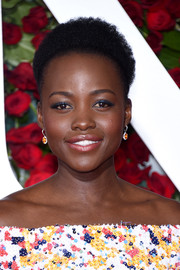 Lupita Nyong'o went all out with the colors, wearing blue eyeshadow with her multi-hued outfit.