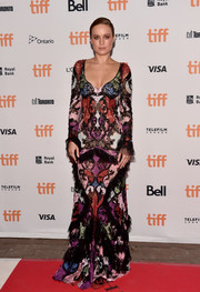 Brie Larson was bold and stylish in a multicolored patchwork lace gown by Alexander McQueen during the TIFF premiere of 'Free Fire.'