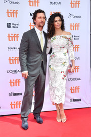 Camila Alves looked breathtaking at the TIFF premiere of 'Sing' in a white Monique Lhuillier off-the-shoulder dress with colorful floral embroidery.