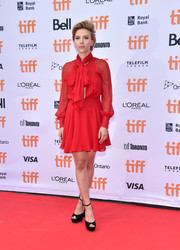 Scarlett Johansson made an appearance at the TIFF premiere of 'Sing' wearing a floaty red tie-neck dress by Haney.