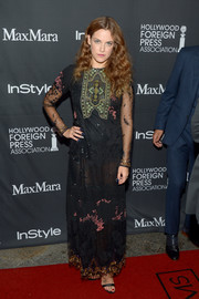 Riley Keough was boho-sexy in a semi-sheer lace maxi dress by Valentino at the TIFF/InStyle/HFPA party.