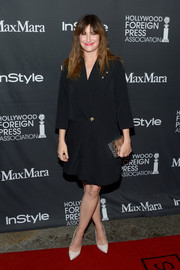 Kathryn Hahn was business-chic in a black tux dress at the TIFF/InStyle/HFPA party.