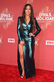 La La Anthony looked sharp in a high-slit metallic-green tuxedo gown by Roland Mouret while attending VH1's Divas Holiday: Unsilent Night.