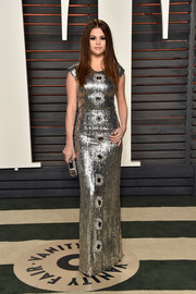 Selena Gomez looked absolutely dazzling in a fitted silver sequin gown by Louis Vuitton at the Vanity Fair Oscar party.