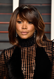 Gabrielle Union sported a soft wavy 'do with side-swept bangs at the Vanity Fair Oscar party.
