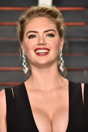 Kate Upton swept her hair back into a disheveled-chic updo for the Vanity Fair Oscar party.