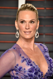 Molly Sims styled her hair into a classic bun for the Vanity Fair Oscar party.