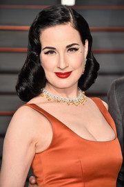Dita Von Teese joined the Vanity Fair Oscar party wearing her signature vintage curls.