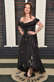 Juliette Lewis chose a Vivienne Westwood signature--off-the-shoulder with a sculptural neckline--for her Vanity Fair Oscar party look.