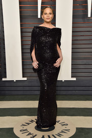 Chrissy Teigen made pregnancy look so glam with this black sequin gown by Talbot Runhof when she attended the Vanity Fair Oscar party.