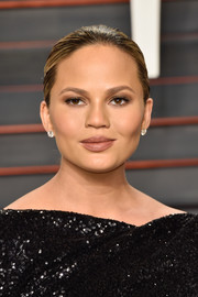 Chrissy Teigen hit the Vanity Fair Oscar party wearing a no-frills bun.