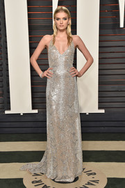 Lily Donaldson was a standout in a fully beaded slip dress by Saint Laurent during the Vanity Fair Oscar party.