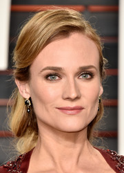 Diane Kruger looked like a fairytale princess with her loose braid at the Vanity Fair Oscar party.