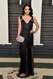 Vanessa Hudgens completed her elegant ensemble with a crystal-studded clutch by Oroton.