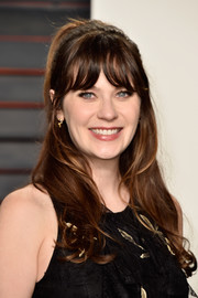 Zooey Deschanel wore a cute half-up hairstyle (with her signature bangs, of course) at the Vanity Fair Oscar party.