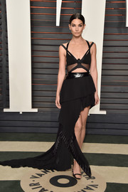 Lily Aldridge went bondage-glam for the Vanity Fair Oscar party in a black Alexandre Vauthier Couture dress with a strappy cutout bodice and a tiered, asymmetrical skirt.