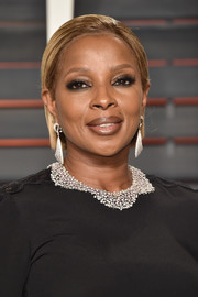 Mary J. Blige sported a slicked-down hairstyle when she attended the Vanity Fair Oscar party.