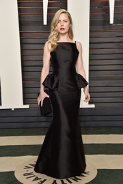 Melissa George cut an ultra-feminine silhouette in this vintage Dior peplum gown at the Vanity Fair Oscar party.