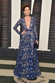 Minnie Driver went for sexy sophistication in a plunging blue floral-embroidered gown by Naeem Khan at the Vanity Fair Oscar party.