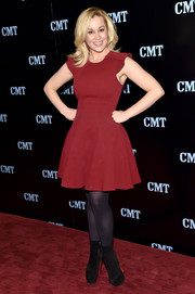 Kellie Pickler opted for a pair of black Louboutin platform boots to complete her look.