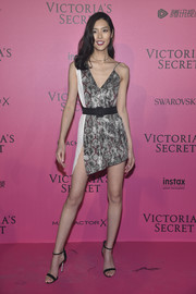 Liu Wen teamed her dress with simple black ankle-strap sandals.