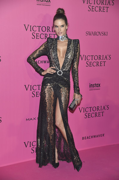 Alessandra Ambrosio complemented her dress with a bedazzled tube clutch by Jimmy Choo.