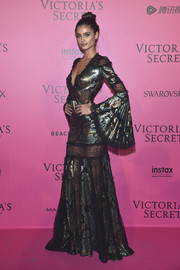 Taylor Hill glammed it up in a metallic lace-panel gown by Roberto Cavalli at the Victoria's Secret fashion show after-party.