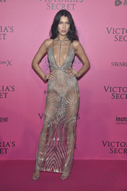 Fresh from the Victoria's Secret runway, Bella Hadid continued the sensual vibe at the after-party with this sheer cutout gown by Julien Macdonald.