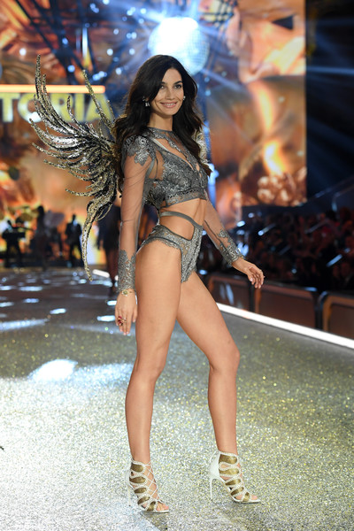 For her footwear, Lily Aldridge donned a pair of gold and white lace-up heels.