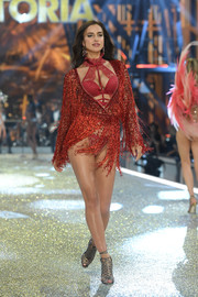 Irina Shayk tantalized in a fringed red top layered over lacy lingerie at the Victoria's Secret fashion show.