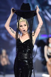 Lady Gaga displayed her toned arms and trumpet tattoo while performing at the Victoria's Secret fashion show.