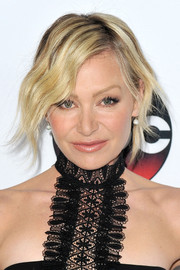 Portia de Rossi swept up her hair in a messy updo at the Winter TCA Tour.