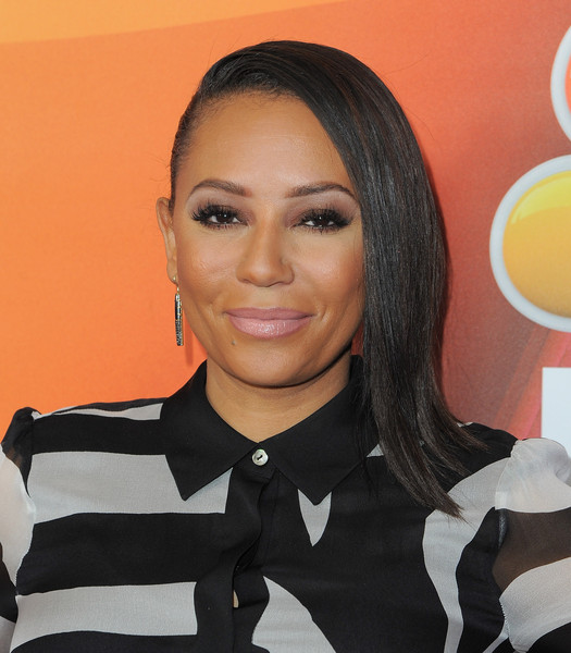 Melanie Brown chose a pale pink hue for her lips.