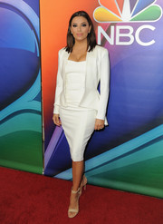 Eva Longoria styled her suit with nude ankle-cuff sandals by Gianvito Rossi.