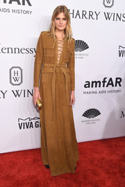 Constance Jablonski was all about hippie glamour at the amfAR New York Gala in a tan suede maxi dress with a lace-up neckline.