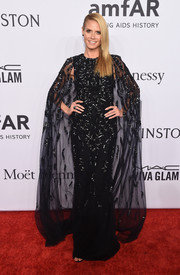 Heidi Klum made a grand entrance in a caped and beaded black gown by Zuhair Murad at the amfAR New York Gala.