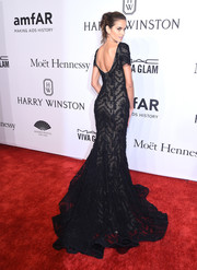Izabel Goulart made a regal entrance in a black Marchesa lace gown with a long train during the amfAR New York Gala.