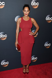 Tracee Ellis Ross matched her dress with a pair of Christian Louboutin cross-strap pumps.