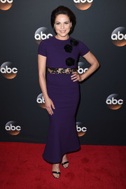 Lana Parrilla looked playfully chic at the 2017 ABC Upfront in a fluted purple dress with black flower appliques and a peekaboo lace midsection.