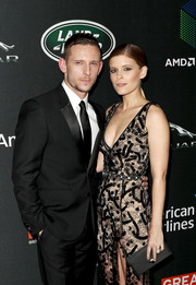 Kate Mara paired a black envelope clutch with a lace dress for the 2017 AMD British Academy Britannia Awards.