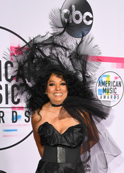 Diana Ross matched her signature big hair with an eye-catching tulle headdress at the 2017 American Music Awards.