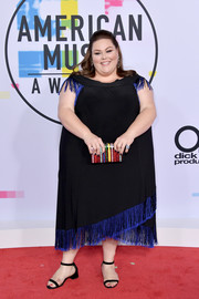 Chrissy Metz chose a black Kiyonna midi dress with a blue fringed hem and shoulders for the 2017 American Music Awards.
